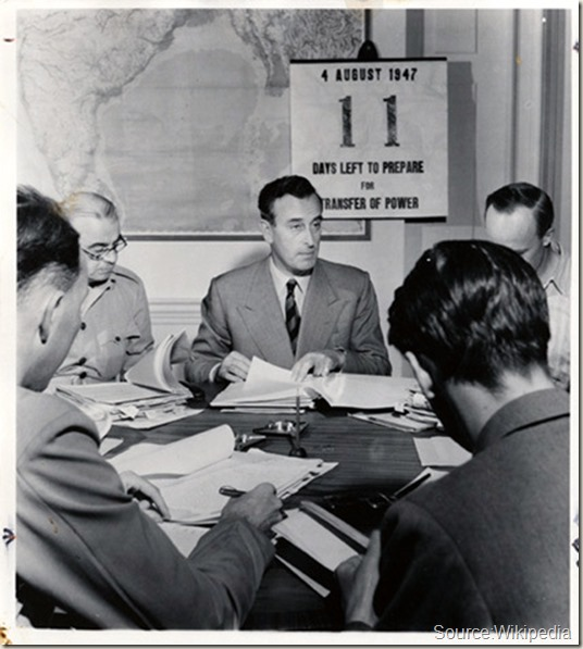 Eleven days before returning independence to India, Lord Mountbatten works with his advisors to divide India peaceably. New Delhi, India, August 4th, 1947. (David Douglas Duncan)